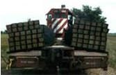 Roller Rex Machine to unload new ties on a Kansas railroad project.