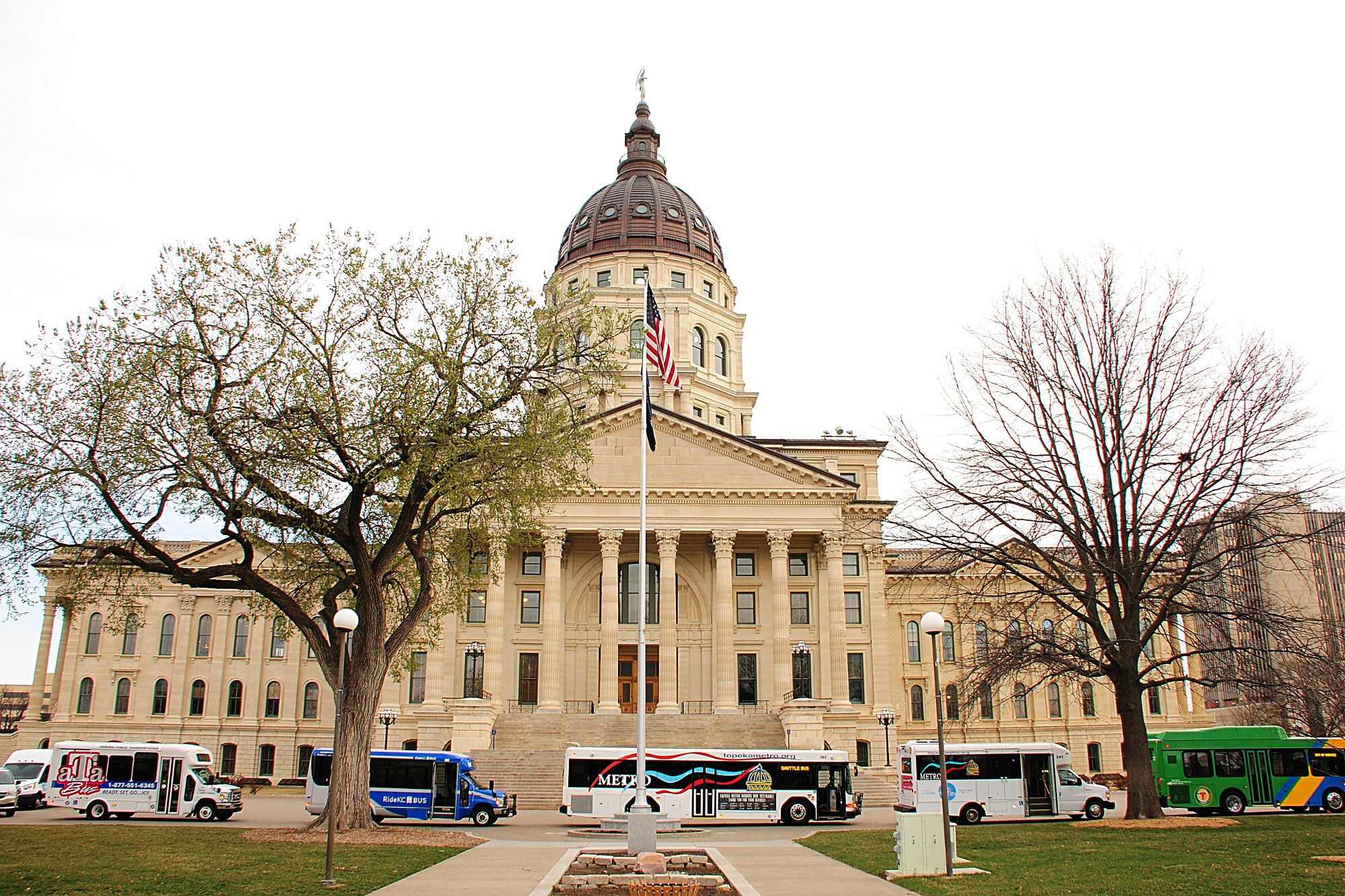 Picture of the Kansas Statehouse with Buses in front of it, March, 2017